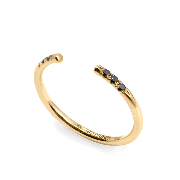 gold open ring with black diamonds