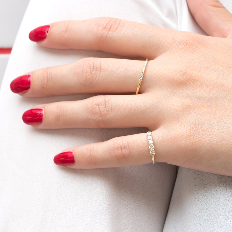 thin gold ring with white diamonds