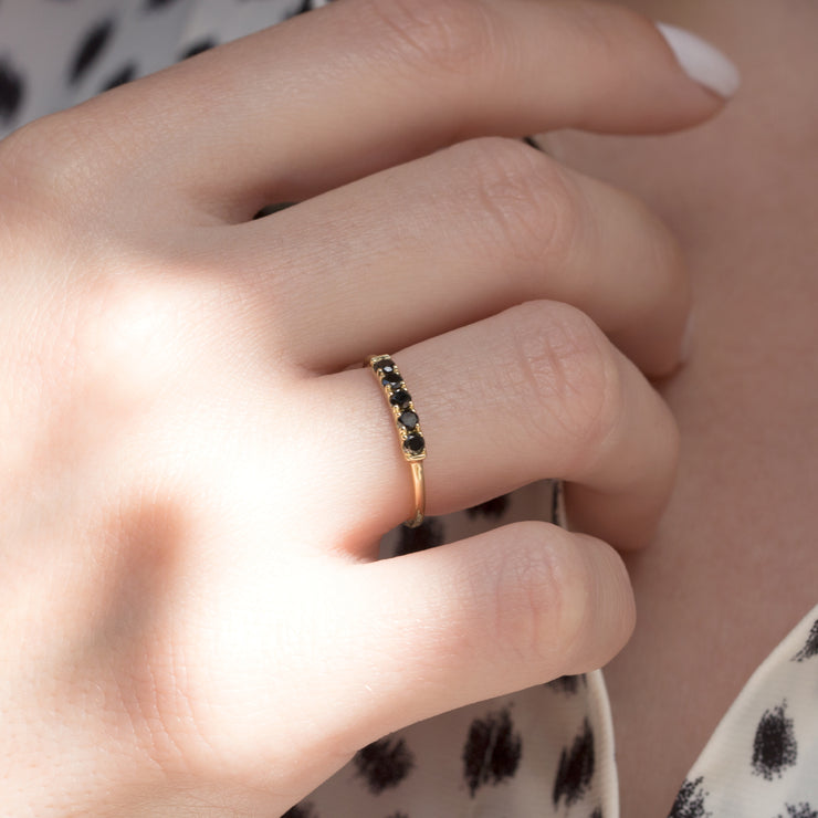 gold ring with black diamonds