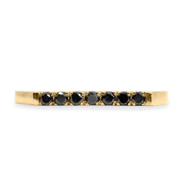 gold ring with seven black diamonds
