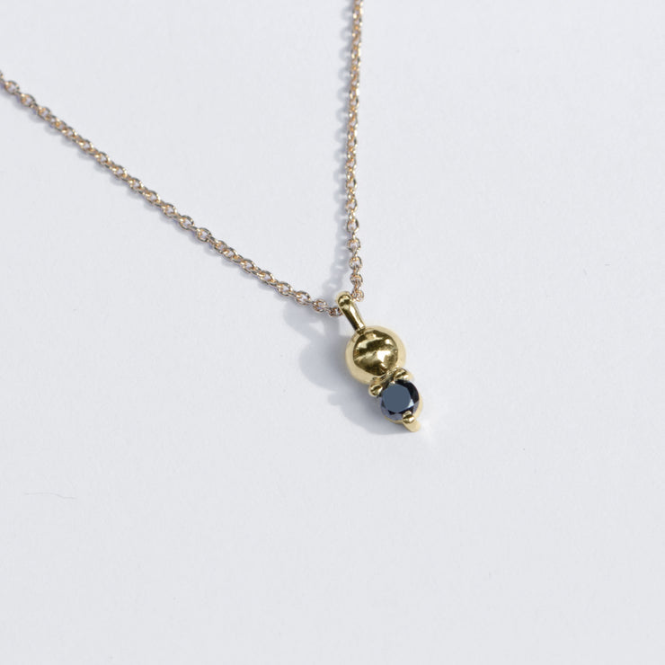 gold necklace with black diamond