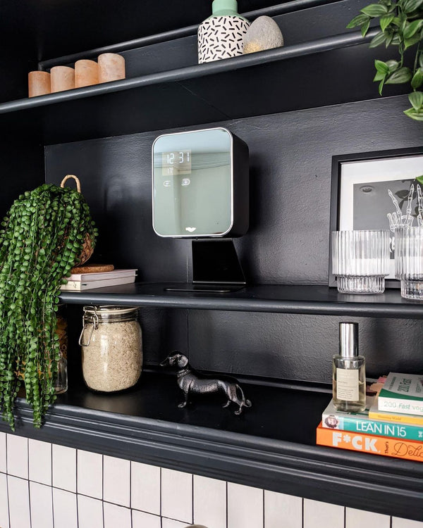 anti Cube black, metal hand sanitizer and soap dispenser free-standing on black wooden shelf