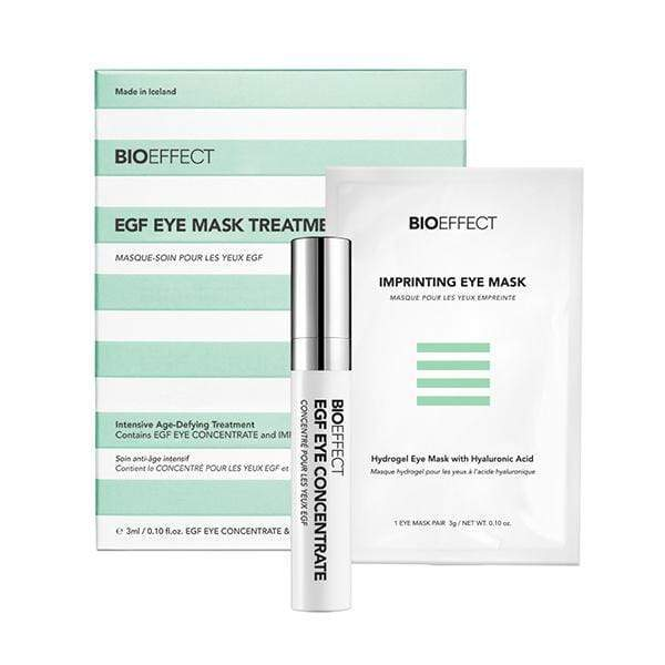 Green-and-white striped square-shaped package of BIOEFFECT Anti Aging Skincare EGF Hydrating Eye Mask Treatment. A small white Imprinting Eye Mask package and an EGF Eye Concentrate roller bottle sit towards the right center.
