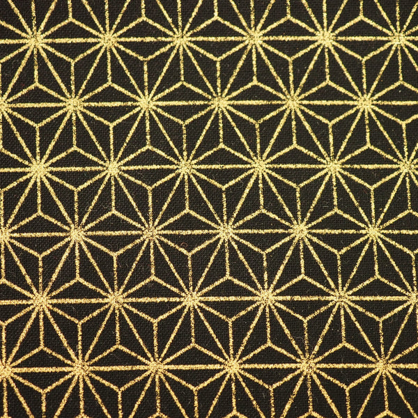 Close-up shot of black Japanese cotton fabric with a gold foiled geometric star motif.