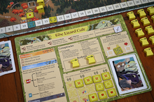 Load image into Gallery viewer, Root board game Riverfolk expansion player mat Lizard Cult