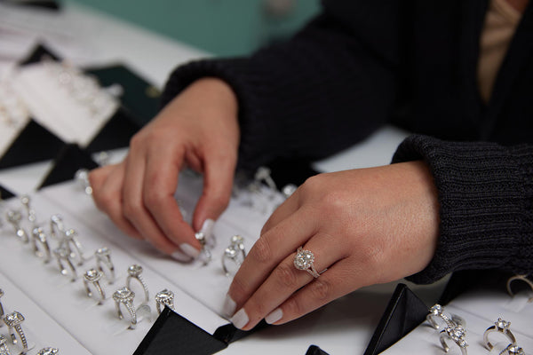A customer trying on our moissanite engagement rings.