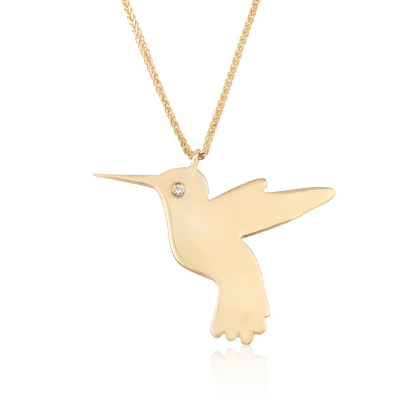 Flying bird gold pendant