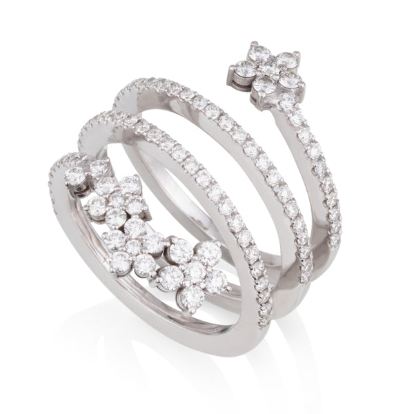 An open diamond pave swirl ring with diamond flowers