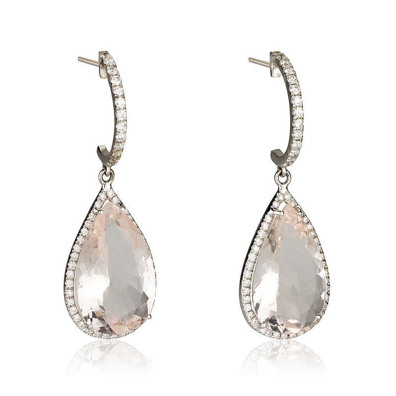 A dazzling pear shaped drop dangling earrings with diamonds