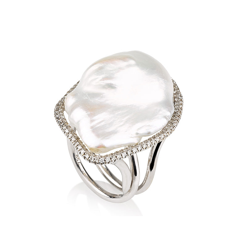 Pearls | An exquisite Baroque pearl ring with diamond halo.