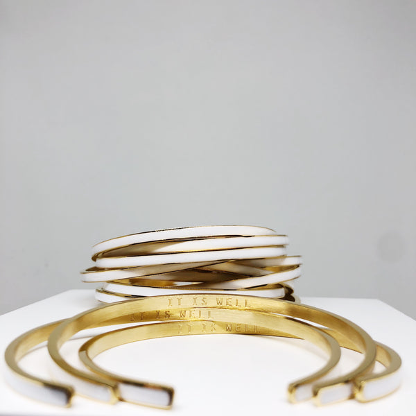 It is well white and gold stacking cuff