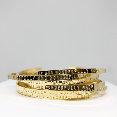 Fearfully and wonderfully made gold stacking cuff