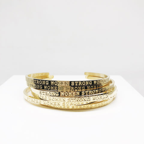Strong women strong world gold stacking cuff