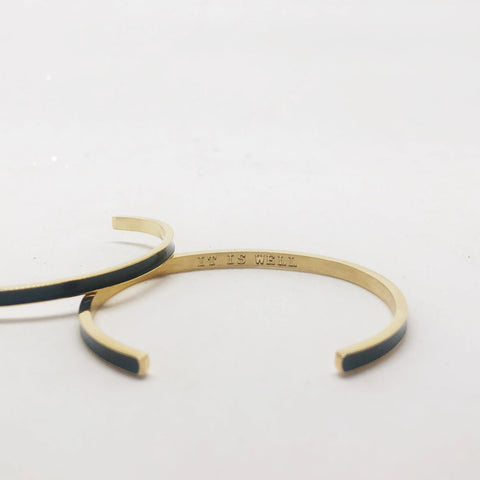 It is well black and gold stacking cuff