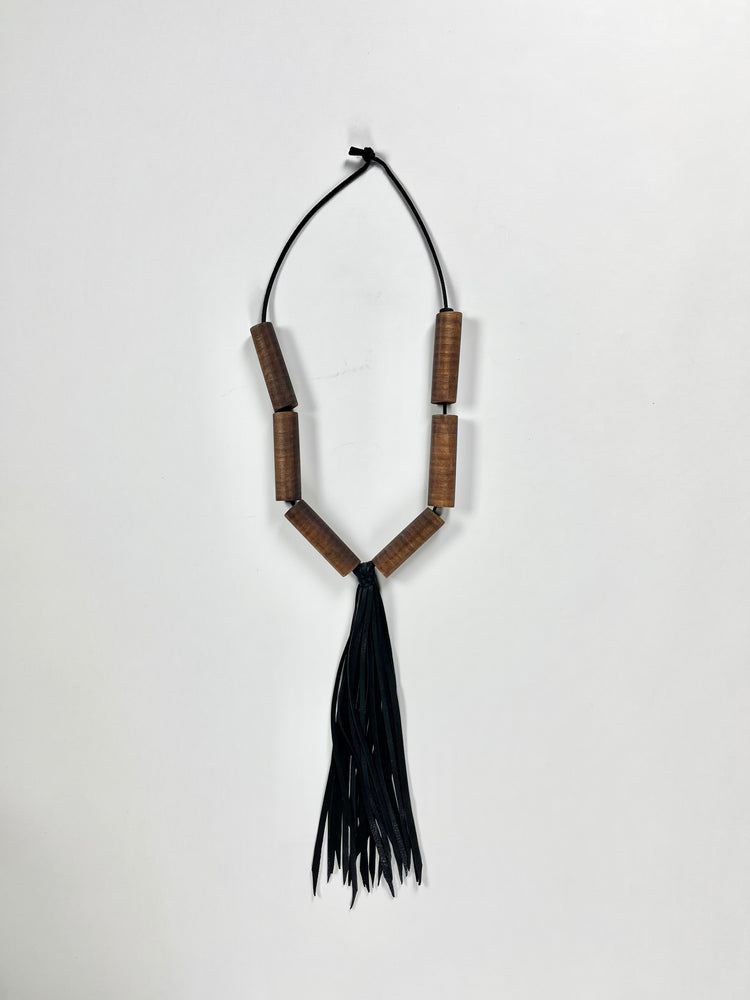 Load image into Gallery viewer, walnut cylinder beads / black deerskin tassel