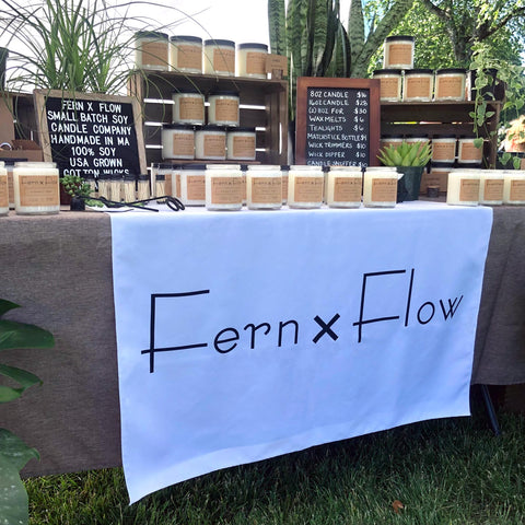 Fern x Flow farmers market soy candle table display
