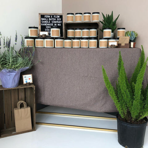 Fern x Flow handmade 100%, soy candles on a table display for sale at Meraki Spa in Lynnfield, MA