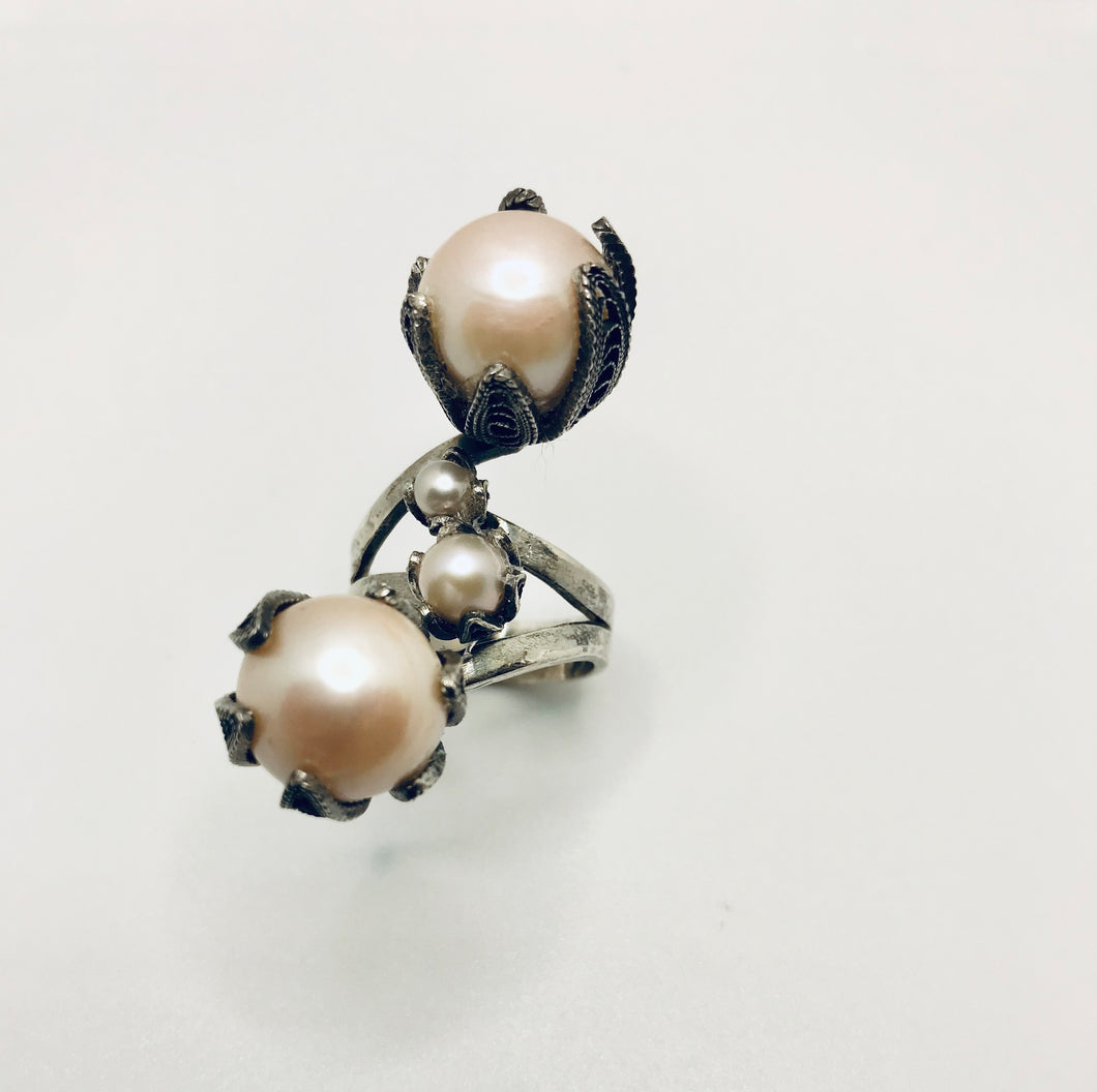 Ring with 2 large crown cups with pink pearl drops and two smaller pearls