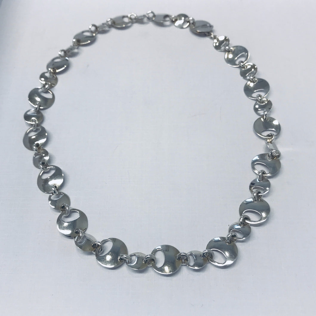 Necklace, round details with oval  holes EXIGN