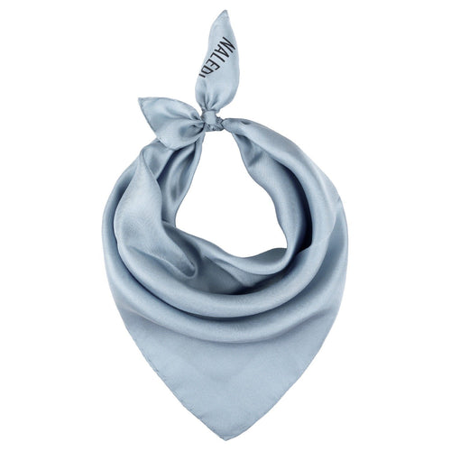 SIMPLY SILK. Tis scarf is a perfect accessory that fits with everything. Wear it around your neck, on your hair or tied at your handbag. 5% of the price of the scarf is donated to Lazarro Spallanzani Hospital in Rome for research on Covid-19.   Colour: Light Grey  Pure silk   Made in Italy  40x40cm approximately