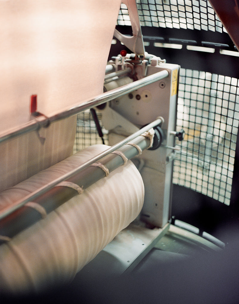 Body of Work - Knitting machine with fabric roll