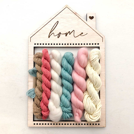 handmade home shape loom for weaving, retro kitchen yarn colors pastel yellow, pinks, turquoise, brown