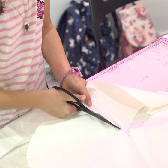kids sewing workshop cutting fabric