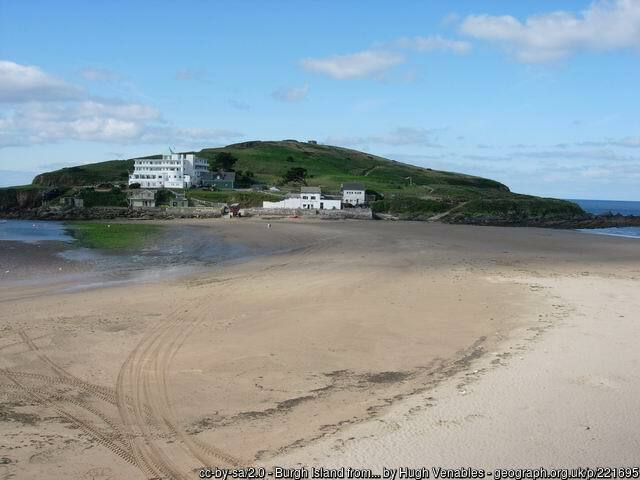 Bigbury beach on a calm day with Burgh island in the background and the pilchard hotel