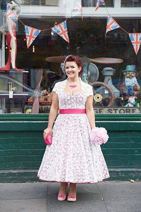 71f184436618 Ivory lace over bright pink satin and pink belt give a modern twist on this  colour tea length wedding dress. We love alternative wedding dresses.