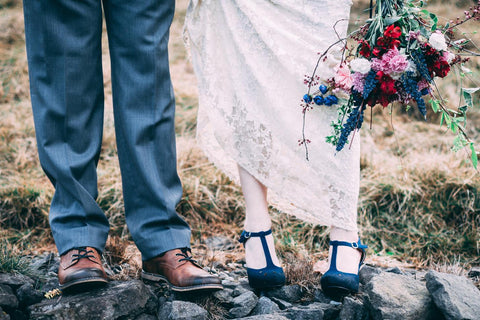 Festival outdoor wedding with bride in lace boho wedding dress and black shoes