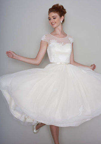 Lola is a pretty 50's style length tea dress with luxury lace appliqué and super full skirt
