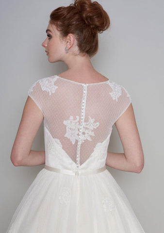 Rear view of the Lola Fifties style length tea dress with luxury lace appliqué and super full skirt