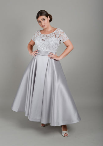Bride wearing silver and ivory short plus size wedding dress