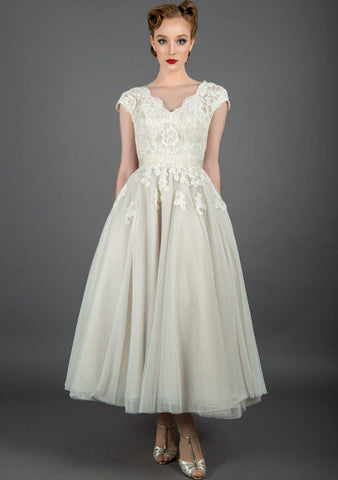 Polly is a tea length wedding dress with vintage inspired lace and tiny dot tulle