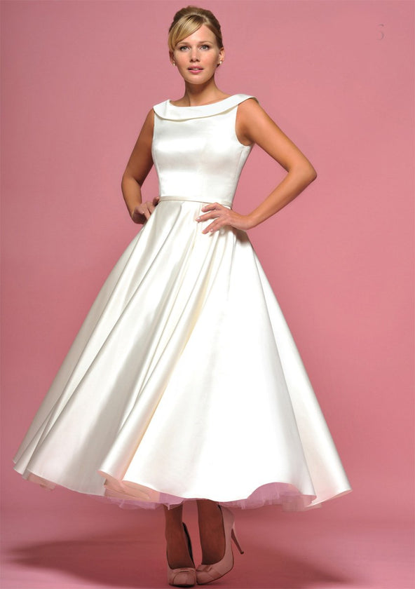 Ivory bridal satin tea length wedding gown with button detail back by Lou Lou.