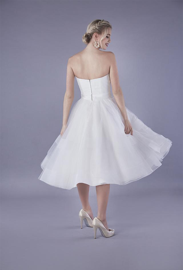 Image of the back of Alba, a satin strapless 50's style wedding gown with short chrin and tulle full skirt.