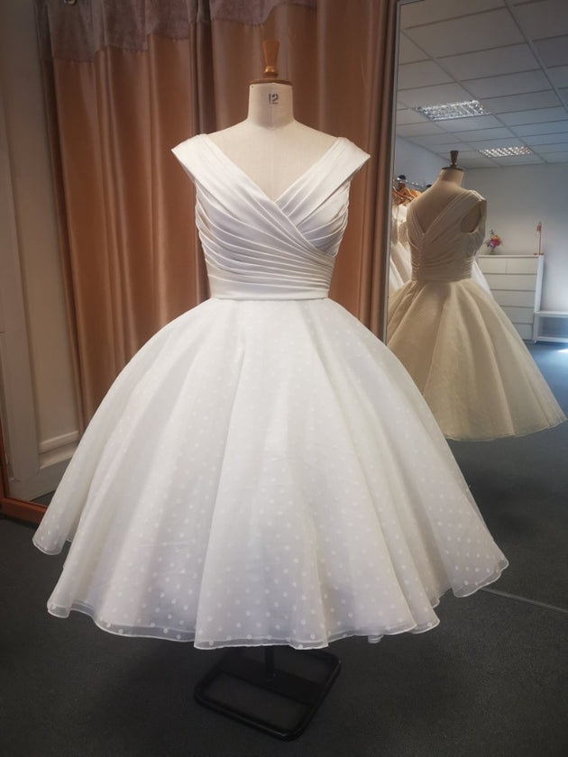 Our Annette deluxe pleated satin bodice with linen spot full tea length skirt bridal gown.