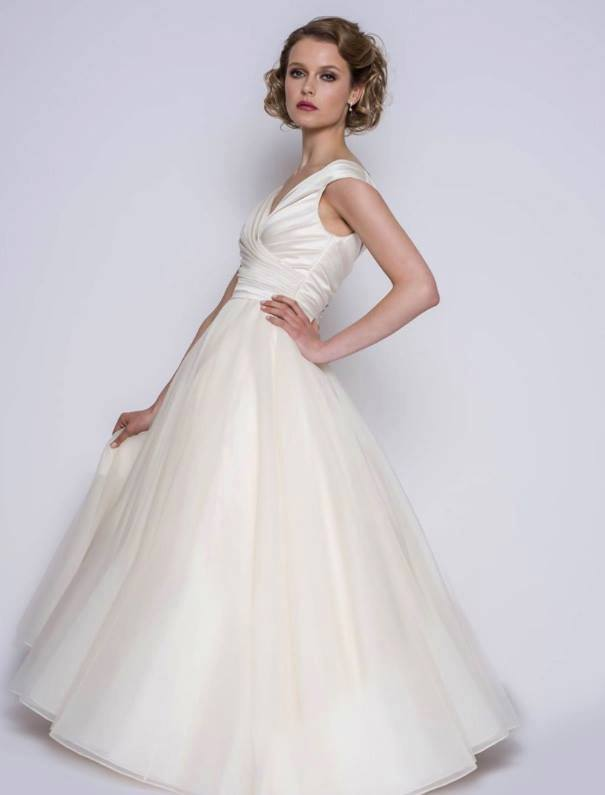 full length satin and organza vintage style wedding dress in ivory
