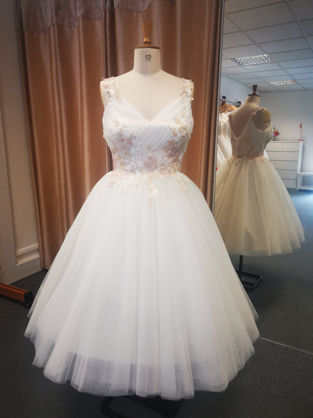 Delicate pleated bodice tulle bridal gown with coloured floral embroidery.