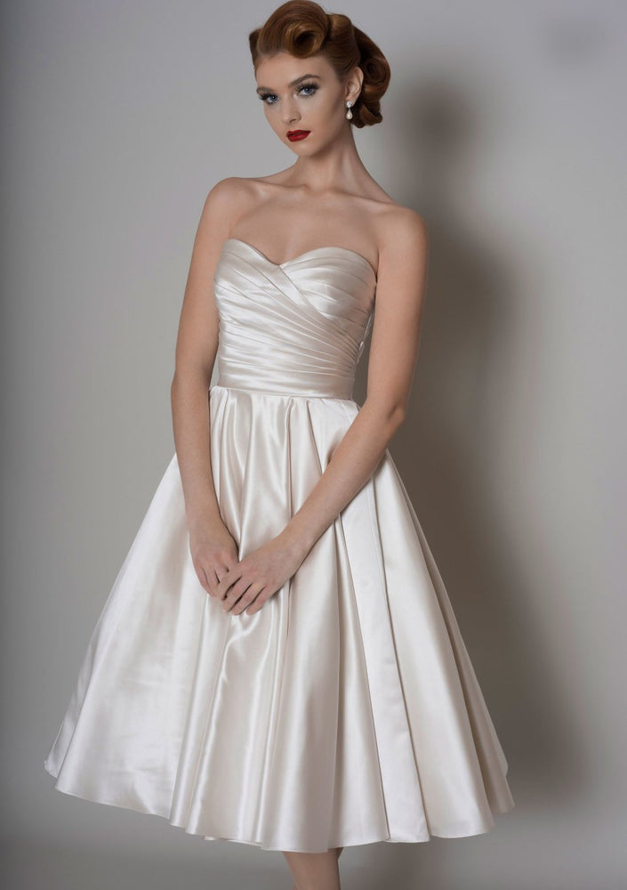 corseted strapless tea length wedding dress