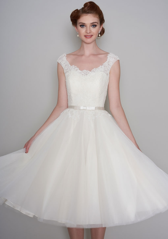 Image of the Flossie tea length Fifties style lace and tulle wedding dress trimmed with a satin bow belt.