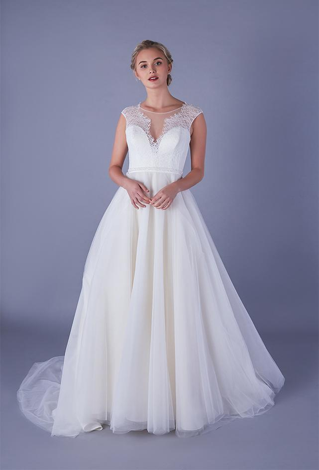 Tea length wedding dress with plunge lace illusion bodice and tulle skirt with pearl and bead waist detailing.