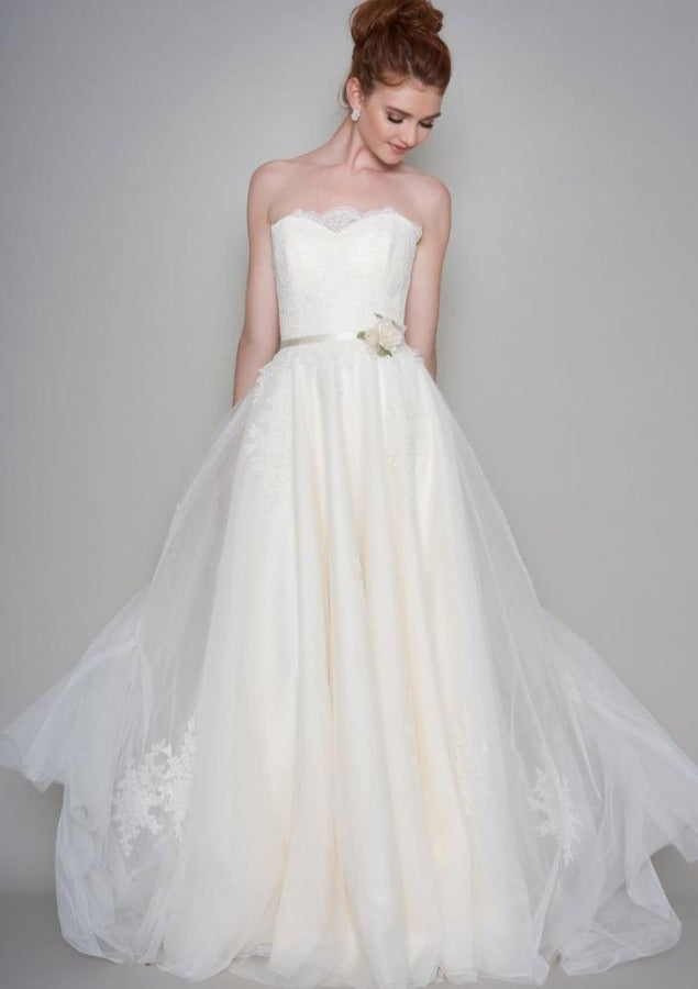 Full length tulle floaty Boho style bridal dress with lace bodice, trimmed with silk organza roses.