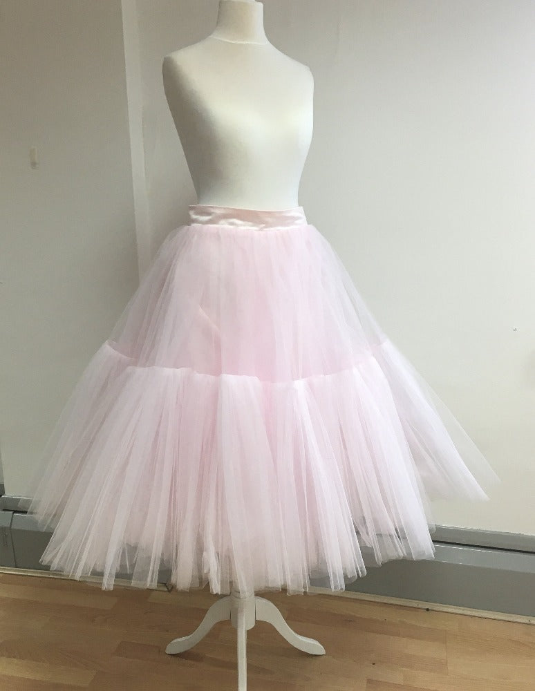 fgm-tiered  Lined tulle tiered skirt with fitted waistband and zip back closure