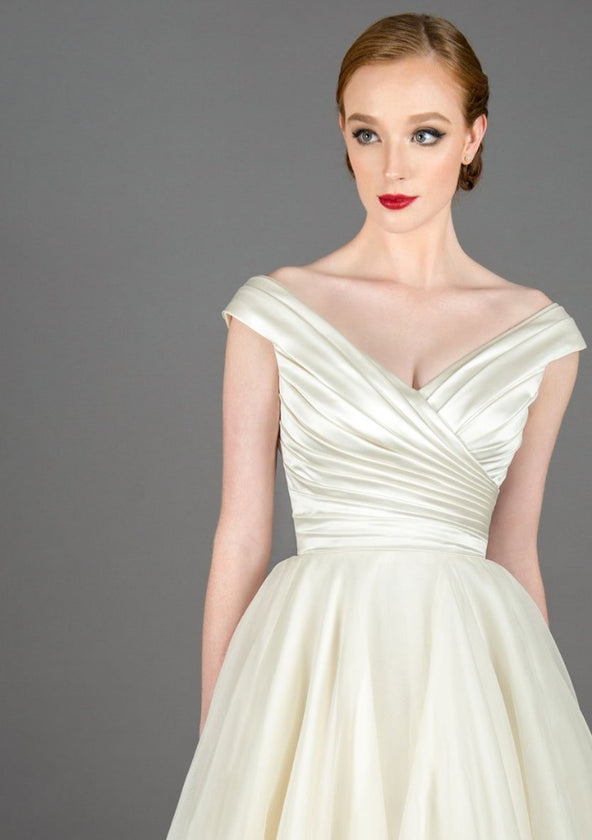 Satin bodice tea length wedding gown