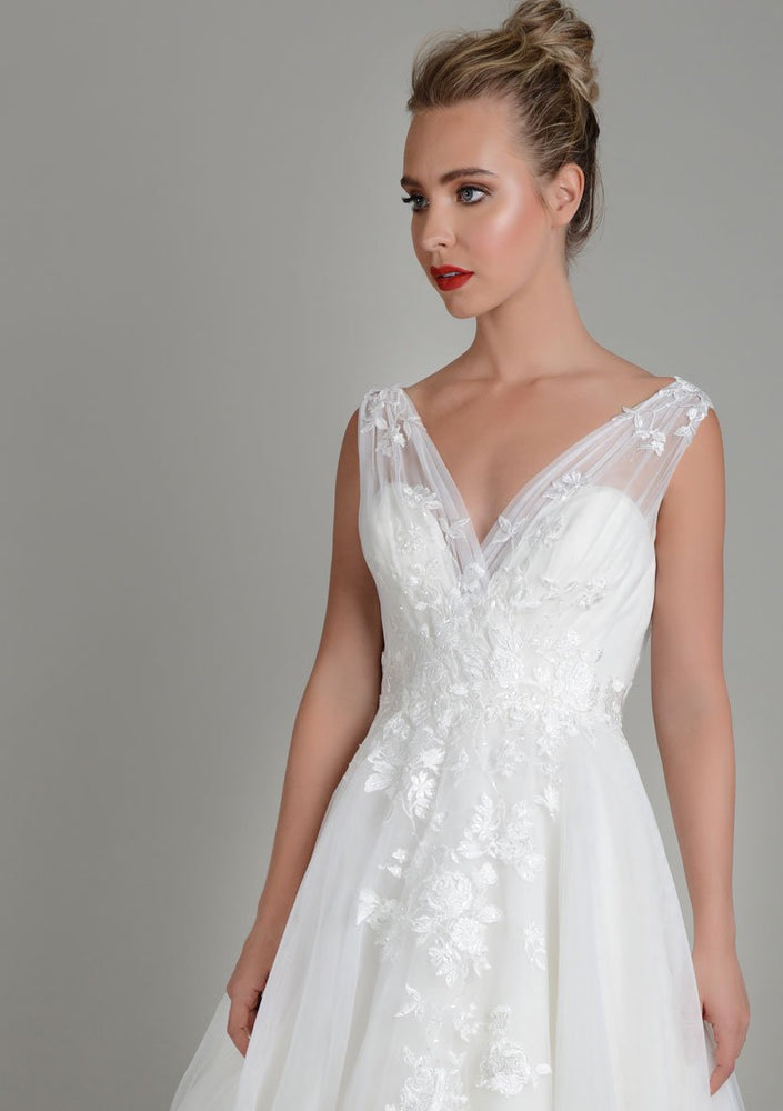 Close up image of Lois Wild Zinnia tea length wedding gown in super soft tulle with delicate lace appliqué