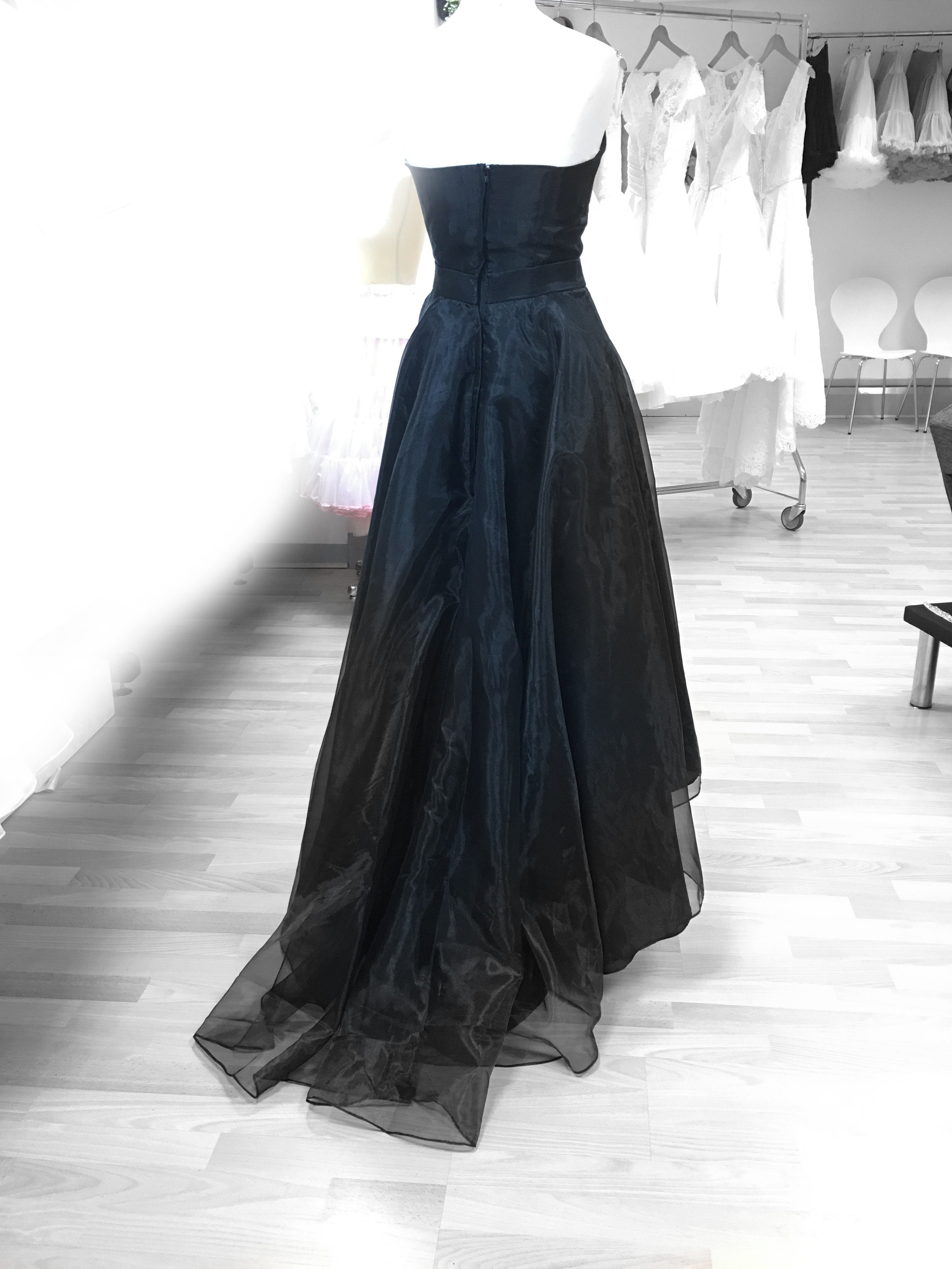 Image shows rear train of Long black organza strapless gown