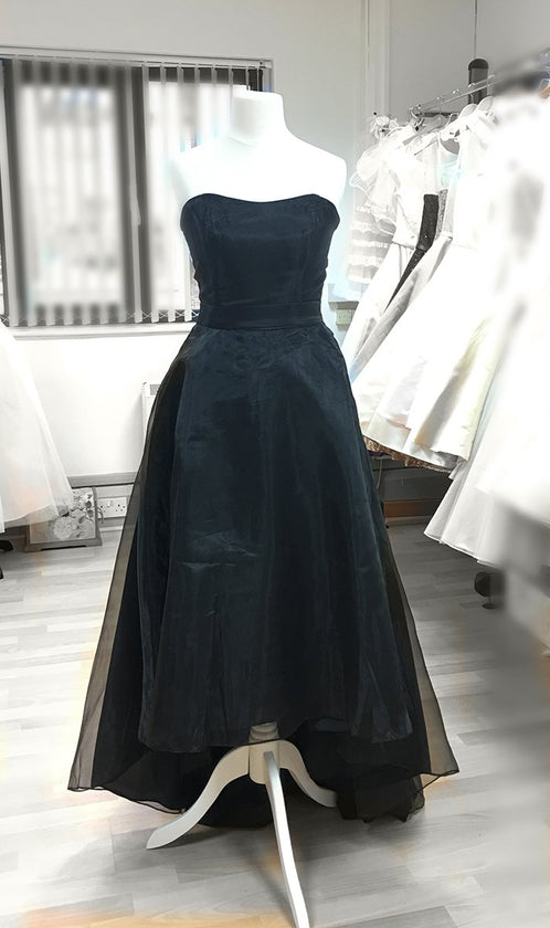 Long black organza strapless gown, shorter at the front, mini train in the back