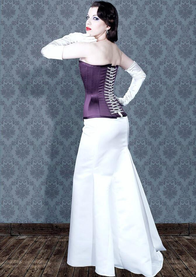 Image of purple satin longer line buskless corset worn with long skirt (not included).