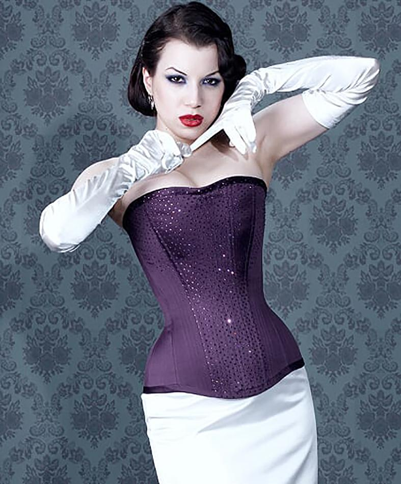 Image of purple satin longer line buskless corset worn with skirt (not included).